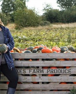 Graceful Blog holding a pumpkin at Foxes Farm Produce Essex Pumpkin Patch.jpeg